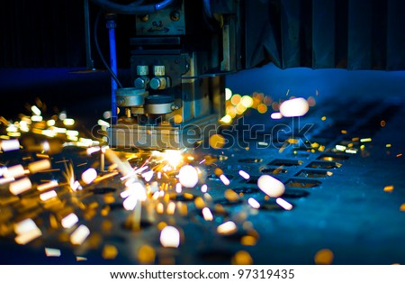 Laser cutting with sparks close up