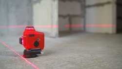 Laser level, construction, finishing work in the room. construction laser Level at work.