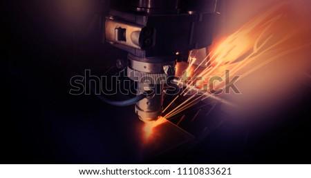 Laser machine, cuts metal, sparks