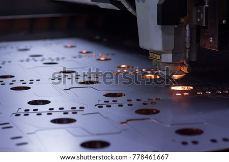 laser machine cutting of sheet metal. Sparks fly from laser by automatic cutting CNC, PLC machine. fabricate work, factory, production #778461667
