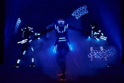 Laser show performance, dancers in suits with LED lamp, very beautiful night club party.