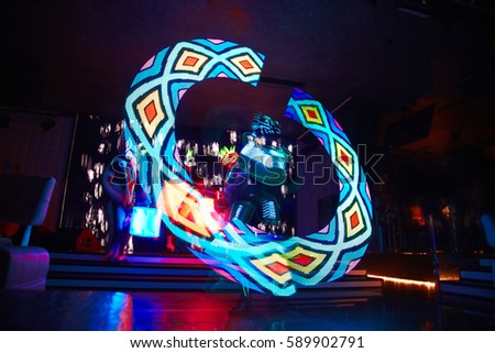 Laser show performance with flames and glowing drums, very beautiful night club performance, party