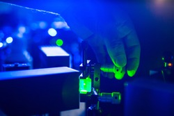 Lasers in a quantum optics lab - Researchers carrying out experiments using lasers