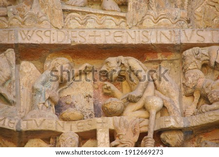 Last Judgment carving showing tortures and punishments of Hell,  from the 13th century, Abbey Church of St. Foy, Conques, France Photo stock ©