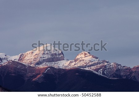 last light of day on the snowy mountains of the Pyrenees, Spain