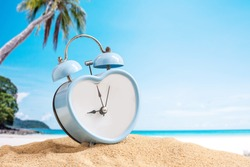 last minute to count down for travel metaphor by old retro clock on sand beach ,abstract background to time for summer vacation or travel vacation concept.