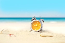 last minute to count down for travel or travel vacation concept. metaphor by old retro clock on sand beach.