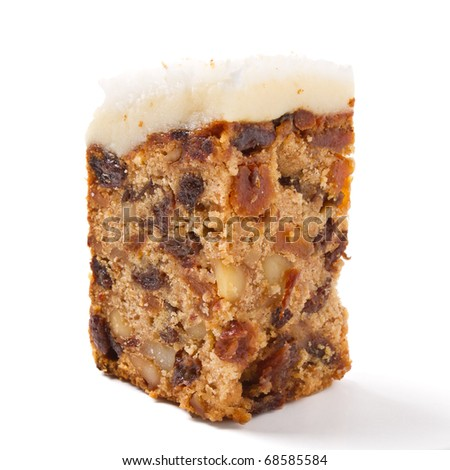 Last piece of christmas cake from low perspective isolated on white.