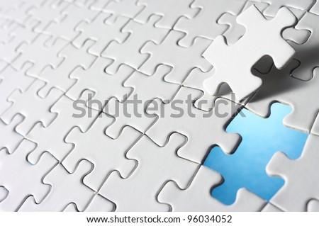 Last piece of jigsaw puzzle. - stock photo