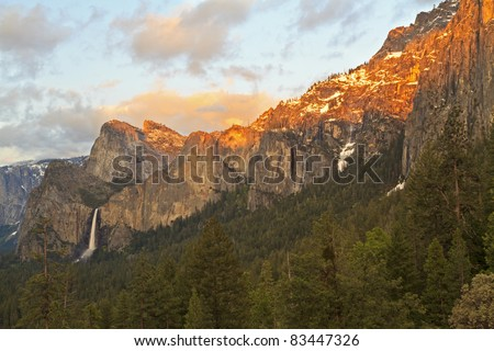 Last rays of sun off the snow and cliffs above Bridalveil Falls in Yosemite National Park, California