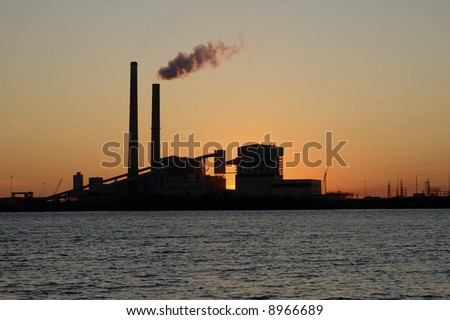 Last rays of the evening sun create an evening silhouette of the power plant.