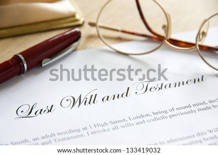 Last Will and Testament concept image complete with spectacles and pen.