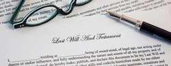 Last Will And Testament Document With Fountain Pen and eyeglasses for Signing. Death And Inheritance Concept.