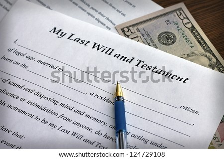 Last Will and Testament form with pen, close-up