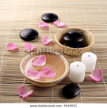 lastone therapy black Pebbles and rose petals in water