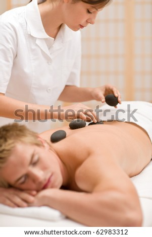 Lastone therapy - man at luxury massage in spa center