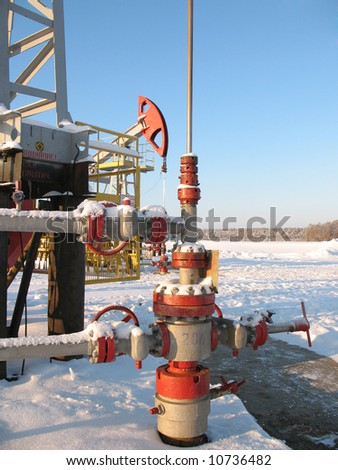 Latch on a oil well. Oil industry. Construction and mechanism in work. Mouth of the oil well.