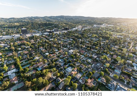 Late afternoon aerial view of Sherman Oaks and Encino in the San Fernando Valley area of Los Angeles, California. #1105378421