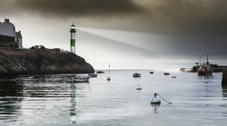 Late afternoon on  stormy day in France, with lighthouse