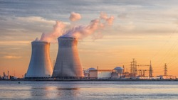Late afternoon scene with view on riverbank with nuclear reactor Doel, Port of Antwerp, Belgium.