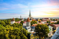 Late afternoon sunset view overlooking the medieval walled city of Tallinn Estonia on an early autumn day in the Baltics region of Northern Europe.