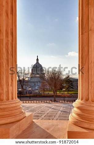 Late afternoon winter sun illuminates front of supreme court in Washington in winter with view of Capitol