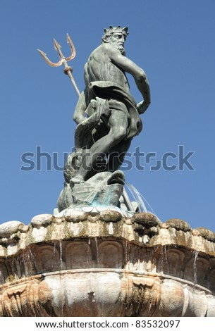 Late Baroque Fountain of Neptune  (Fontana di Nettuno) on main Square in italian  town Trento