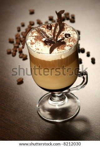 late coffee with chocolate and coffee grains