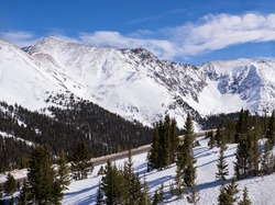 Late January view of the the Mountains that rise above Colorado Highway 6, which goes over the Continental Divide.  Loveland Pass at 11,990 Feet, with a view of the Continental Divide Mountains.