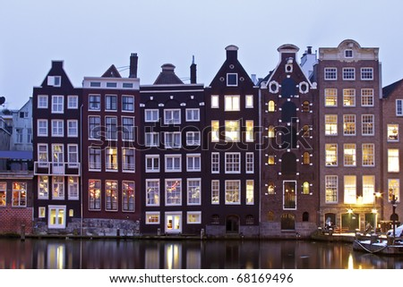 Late medieval houses in Amsterdam by twilight in the Netherlands
