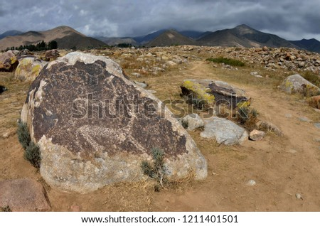 Late Stone Age art -  ancient petroglyphs depicting deers,archaeological site near Cholpon Ata, Issyk-Kul lake shore, Kyrgyzstan,Central Asia