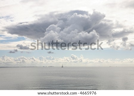 Late summer ocean sky with cloud predicting thunderstorm (Single Cell Cumulonimbus). The Sound, Denmark. Distant coast of Sweden.