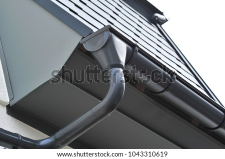 Lateral coated metal Panel, coated Rain Gutter and Rain Water Pipe at a Roof, covered with Metal Shales #1043310619