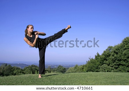 lateral kick - attractive young woman practicing self defense