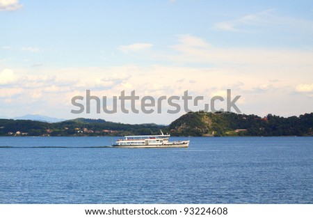 Lateral view of a ferry navigating in a lake