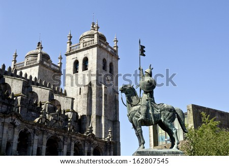 Lateral view of the bell towers of the Porto Cathedral and Statue of Vimara Peres, first Count of Portucale in the 9th century
