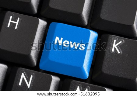 latest internet news concept with a blue button on computer keyboard