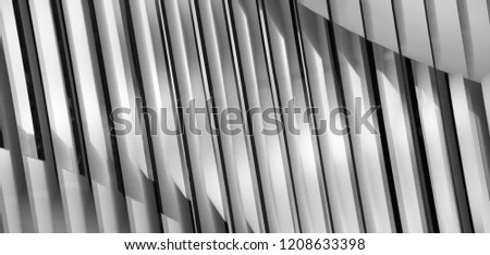 Lath structure of ceiling, wall or roof. Black and white close-up photo of modern architecture or interior fragment with shadows. Abstract architectural background in chiaroscuro technique.