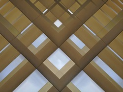 Lath structure of roof or ceiling. Close-up photo of minimalist architecture of modern building. Abstract geometric background with parallel lines on real estate, industry or technology.