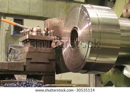 stock-photo-lathe-turning-stainless-steel-30535114.jpg