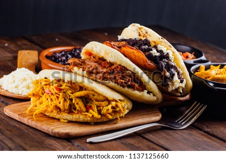 Latin American breakfast, specifically in countries such as Venezuela and Colombia, Arepas with several ingredients to fill like chicken, meat, black beans, fried plantain.
