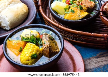 Latin American chilean food. Traditional chilean cazuela de cerdo with chuchoca. Pork soup with potatoes, pumpkin. corn served in clay bowl from Pomaire