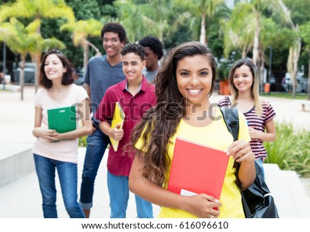 Latin american female student with group of international students