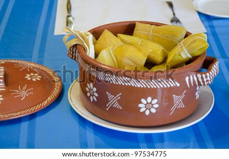 Latin American typical dish made of corn: tamal - stock photo