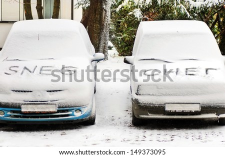 latin and cyrillic snow letters written on automobiles