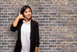 latin business woman doing telephone gesture