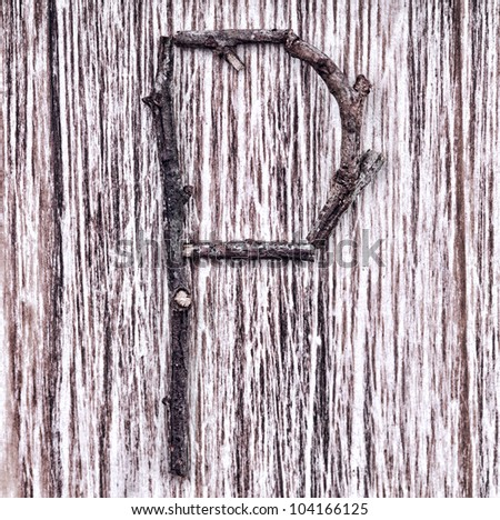Latin capital alphabet letter P made from  sticks on vintage surface