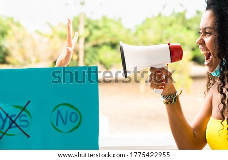 Photo of Latin girl screaming at another person. Free space to write something in. Image