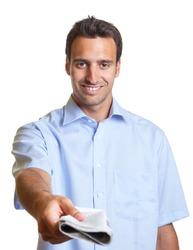 Latin man hands over a newspaper