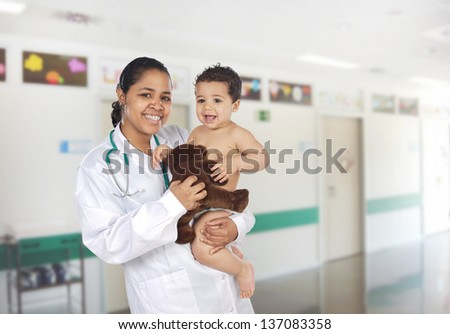 Latin pediatrician at the hospital with a beautiful baby